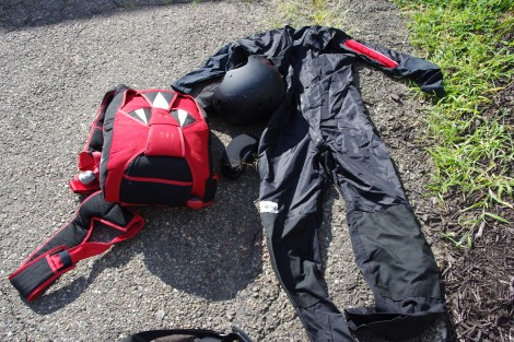 Skydiving equipment: Container/Parachute, Helmet, Kneepads, Altimeter, Log Book, Gloves and Jumpsuit.  Stuffed in a big duffel bag.
